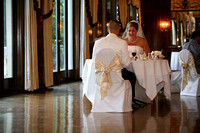 Bride and groom sitting down for dinner reception at the Wisconsin Club in Milwaukee